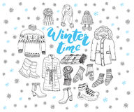 Winter season set doodle elements. Hand drawn sketch colection with boots, clothes, warm blanket, socks, gloves and hats. Letterin Royalty Free Stock Images
