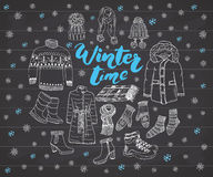 Winter season set doodle elements. Hand drawn sketch colection with boots, clothes, warm blanket, socks, gloves and hats. Letterin Stock Photo