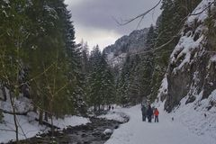 Walks in the mountains in the snowy scenery royalty free stock photos