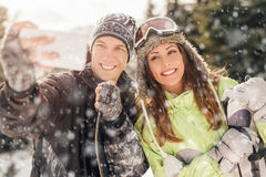 Winter Selfie. Portrait of a beautiful smiling couple taking selfie on winter vacations Royalty Free Stock Image