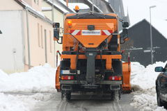 Winter service vehicle. In use in heavy snow-fall Royalty Free Stock Images