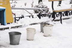Winter. Set of water through the comb into several buckets Stock Photography