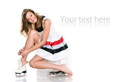Winter nice girl in skates and white dress Stock Photos