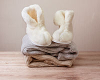 Winter sheepskin slippers (Selective focus) Stock Photo