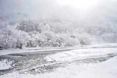 Winter at Shirakawa-go village in Gifu, Japan. Winter scenery with sleet and the river in Gifu, Japan Royalty Free Stock Images