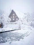 Winter at Shirakawa-go village in Gifu, Japan. A wooden house at sleet in Shirakawa-go village in Gifu, Japan. Shirakawa is a leading area of heavy snowfall in Stock Images