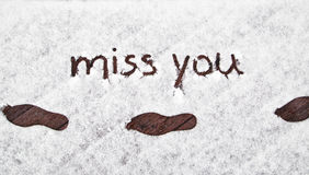 Winter shoe prints with handwritten miss you snow Royalty Free Stock Photography