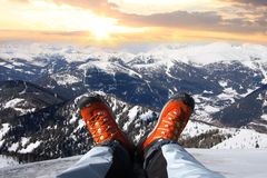 Winter shoes against sunset over the Alps Royalty Free Stock Photography