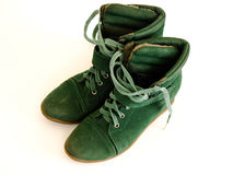 Winter Shoes. Green Women`s Winter Shoes in white Background Stock Image