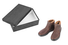 Winter shoes and open box Royalty Free Stock Photography
