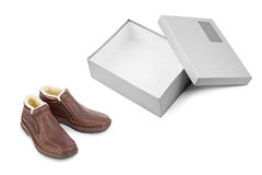 Winter shoes and open box Stock Photography