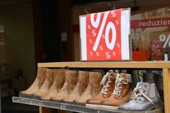Winter shoes for sale. Seasonal discount on shoes.  royalty free stock image