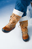 Winter shoes in snow. Close-up view Stock Photo