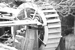 Winter Shoot. Old mill wheel black and white Royalty Free Stock Photos