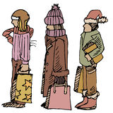 Winter Shoppers. An image of three winter shoppers Royalty Free Stock Photos