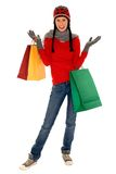 Winter shopping. Woman in winter clothing holding shopping bags Royalty Free Stock Images