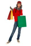 Winter shopping. Woman in winter clothing holding shopping bags Royalty Free Stock Image