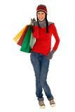 Winter shopping. Woman in winter clothing holding shopping bags Stock Image