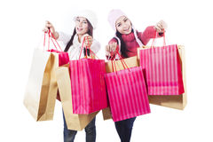 Winter shopping with bags isolated in white Royalty Free Stock Photography