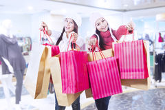 Winter shopping with friends at mall Stock Image