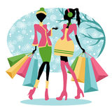 Winter shopping girls Stock Photos