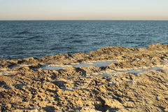 Winter shore of the Caspian Sea. Royalty Free Stock Images