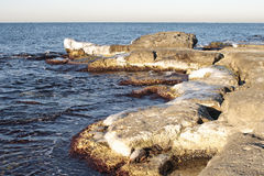 Winter shore of the Caspian Sea. Stock Photos