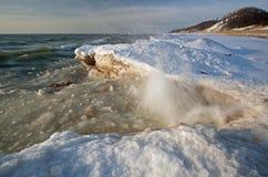 Winter Shoreline Lake Michigan. Landscape of iced winter shoreline of Lake Michigan with splashing wave, Saugatuck Dunes State Park, Michigan, USA Royalty Free Stock Image