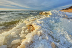 Winter Shoreline Lake Michigan. Landscape of iced winter shoreline of Lake Michigan with splashing wave, Saugatuck Dunes State Park, Michigan, USA Royalty Free Stock Images