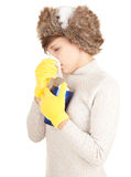 Winter sick young woman keeping big blue cup Stock Photo