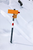 Winter sign. Snowy winter landsape with yellow sign, Laax, Switzerland Stock Photo