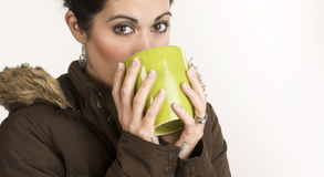 Woman in Winter Coat Sipping Drink from Coffee Cup Stock Image