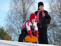 Winter sisters fun Stock Image