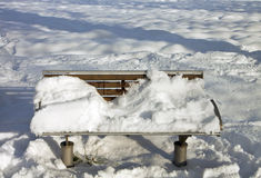 Winter, sitting bench covered by snow Stock Photo