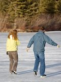 Winter Skate. A young couple enjoys a leisurely skate in winter stock photography