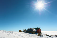 Winter ski chalet. And cabin in snow mountain landscape stock photography