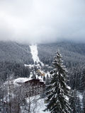 Winter ski landscape. Photo of winter lodge with mountain under fog Stock Images