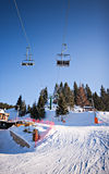 Winter ski lift chair snowy landscape Royalty Free Stock Image