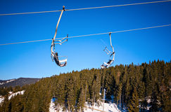 Winter ski lift chair snowy landscape Stock Photos