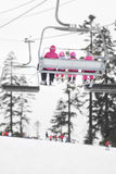Winter ski lift riders. Sport and recreation Royalty Free Stock Photos