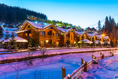 Winter ski resort Bukovel, Ukraine. Scenic winter view of mountain ski resort with snowy house cottages with forest and skiing slope in Bukovel, Ukraine stock image
