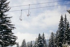 Winter ski resort and snowy forest background Stock Photos