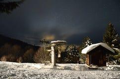 Winter ski slope house on dark sky Stock Image