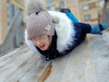 Winter skiing on a wooden slide stock image
