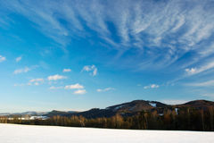 Winter landscape. Evening view of a winter landscape with high wispy clouds in a blue sky Royalty Free Stock Photography