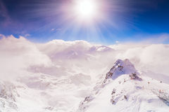 Winter sky extremely highly mountains wind clouds sun beam bokeh abstract background Stock Images