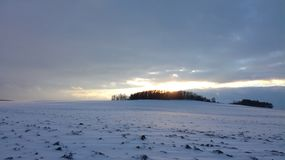 Winter sky - hill. Winter sky, sun lights shining through the clouds Stock Photography