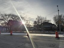 Winter Sky Lights. While standing on the bus stop, the sun his behind the trees Stock Images