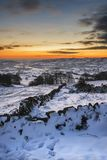 Stunning Winter sunset over snow covered Winter landscape in Pea Stock Images