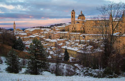Winter sky over Urbino city covered by snow Stock Photo